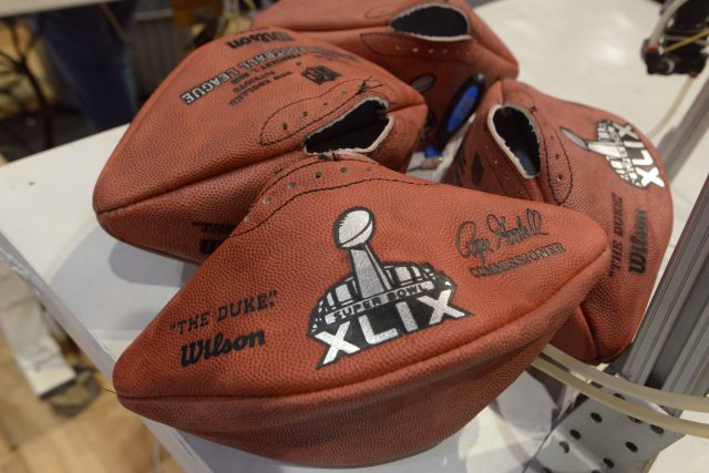 Jan 24, 2015; Phoenix, AZ, USA; Deflated footballs with Super Bowl XLIX logo at the NFL Experience at Phoenix Convention Center in advance of the game between the Seattle Seahawks and the New England Patriots. Mandatory Credit: Kirby Lee-USA TODAY Sports