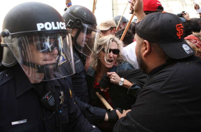 Donald Trump protestors clash with officers during the California GOP Convention held at the Hyatt Regency San Francisco Airport in Burlingame, California on April 29, 2016. (Joel Angel Juarez/Special to S.F. Examiner)