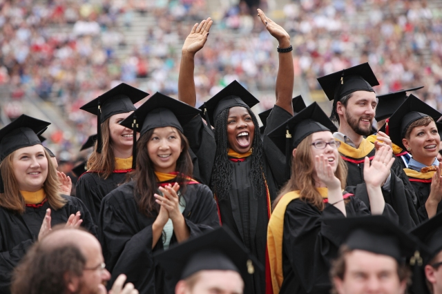 Graduates react after being recognized for their degree during the University of Wisconsin-Madison spring commencement ceremony ceremony at Camp Randall Stadium in Madison, Wis., Saturday, May 16, 2015. (Amber Arnold/Wisconsin State Journal via AP)
