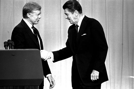 President Jimmy Carter, left, and Republican Presidential candidate Ronald Reagan, shake hands Tuesday night, October 28, 1980, in Cleveland, Ohio, before debating before a nationwide television audience. (AP Photo/stf)